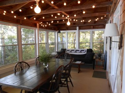 Nice big porch with futon. Table will sit 8 using bench