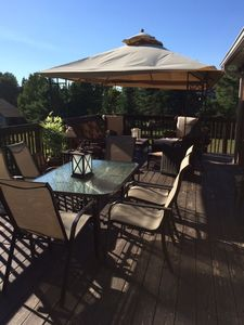 Summer Rest deck- barbeques, children's table, dining table, new high back rattan lounge chairs.