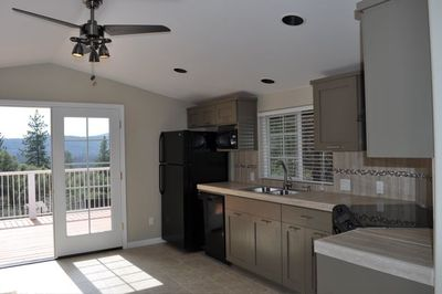 This stylish kitchen is fully stocked with all the amenities.