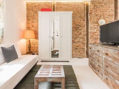 Photo for Petit Chueca apartment in Malasaña with WiFi & air conditioning.