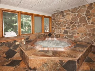 Photo for Charming Ski-In Condo w/ Private Hot Tub, Kids Ski Free & Worry-Free booking!