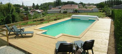 Photo for LE MERLE - a detached Holiday Farmhouse with in ground Heated Pool and gardens