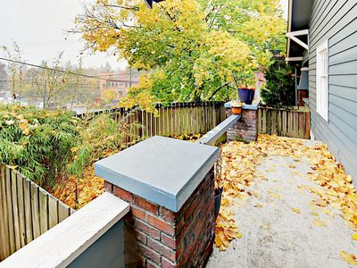 Exterior - Enjoy a cup of coffee on the balcony of your upper-floor rental.