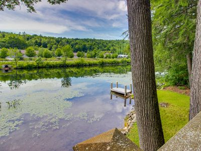 Photo for Quaint lakefront home with a private deck, firepit, and dock!