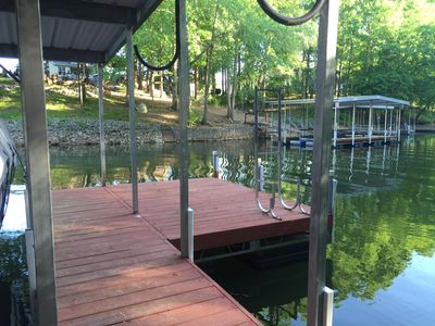 Swim deck with ladder.  Kayak hooks are available.