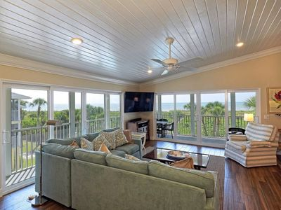 Photo for Completely updated top floor condo. Heated pool and tennis court. Beach front