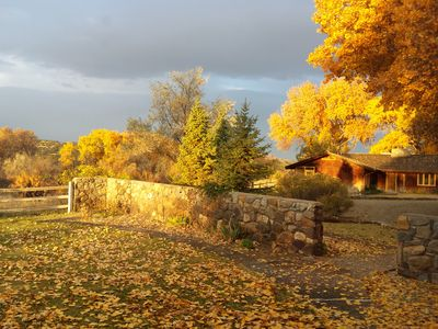 Golden Fall sunrise shining on the ranch Guest House