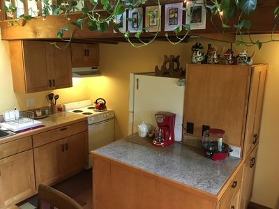 The full kitchen has extensive cupboard space, granite countertops, accessories.