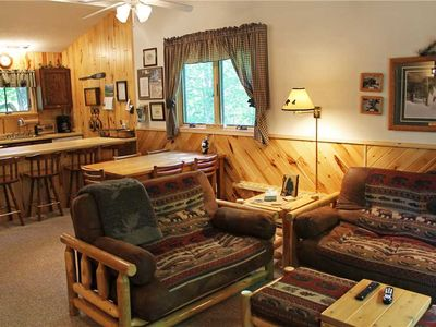 Photo for A Cheery Condo-Style Vacation Home with Lovely Northwoods Décor Nestled in the Woods