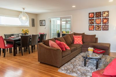 """Large open living room and dining area. Sofa bed in living room. 50""""  LCD TV."""