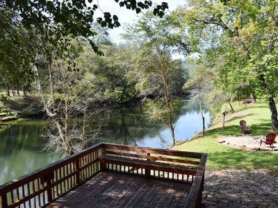 Photo for The Fish Trap Cabin on the beautiful lower Toccoa River, famous for it`s big trout fly fishing! A pr