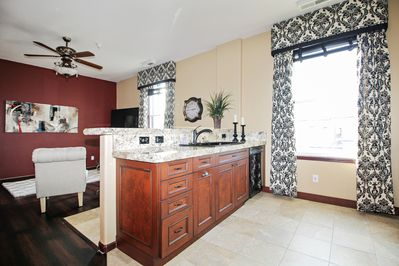 Fully stocked kitchen has granite counter tops