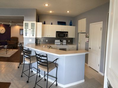 Open kitchen with 3 bar stools