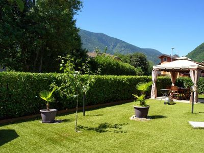 Photo for Charming 3½-room apartment with large garden with gazebo and barbecue
