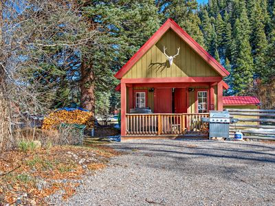 Photo for Riverside cabin w/private hot tub, wood stove, deck & river views