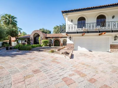 Photo for NEW LISTING! Spacious home w/heated pool, media room, pool table & putting green