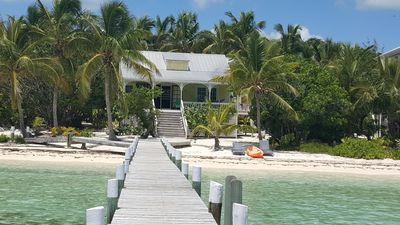 Photo for Sandy beachfront paradise with dock and a/c bedrooms at Green Bananas Cottage
