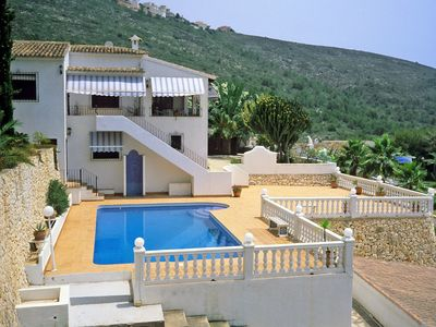 Photo for This 5-bedroom villa for up to 10 guests is located in Moraira and has a private swimming pool and W