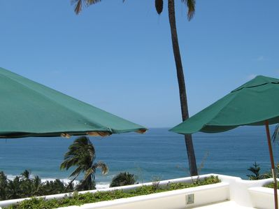 The deck at CasaBlanca is equipped with umbrella tables, a grill & lounge chairs