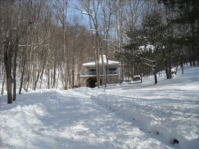 Front of house in winter, lots of snowy hills for sledding on our 6.5 acres.