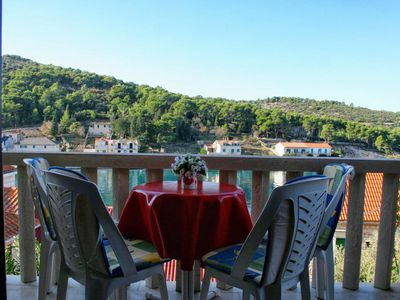 Photo for Two bedroom apartment with terrace and sea view Povlja (Brač)