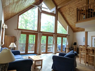 Photo for Beautiful 3BR river view, huge glass wall Log House -2200 sq/ft