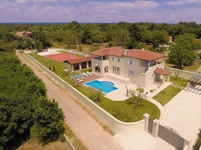 Photo for Stylish Villa ***** with heated swimming pool, summer kitchen and sports ground