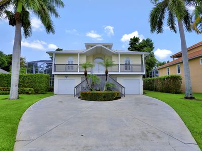 Photo for Entrancing Florida-style home w/ heated pool and short walk to beach