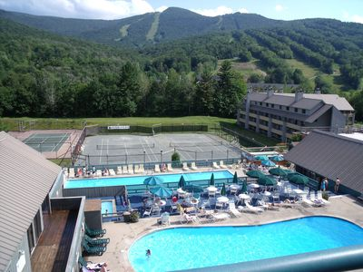 View from the deck showing pools and tennis courts