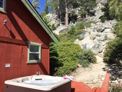 The perfect red cabin with your own private hot tub! Sleeps 6 comfortably with a TV in every room, full cable and high-speed internet