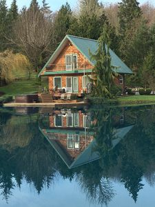 Reflection of the cabin in the pond.