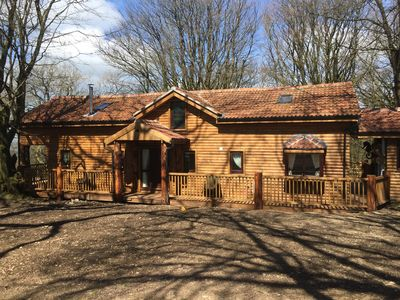 Photo for 'The Grand' Log Cabin With Hot Tub at Mockham Down Farm, Devon