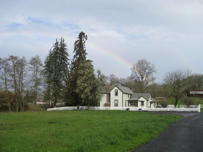Pearce House as seen from Dawson Road - a rainbow brightens the sky.