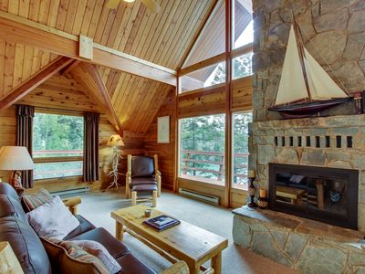Photo for Three-level lakefront cabin in the woods w/ large docks, two decks, & media room