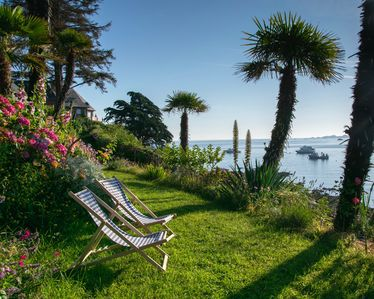 Photo for Lancelot islet, sea view and feet in the water