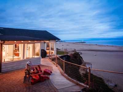 Seabright Bungalow's private side patio, overlooking the bluff at dusk.