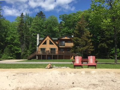 Photo for Lakefront Log Home with sandy beach