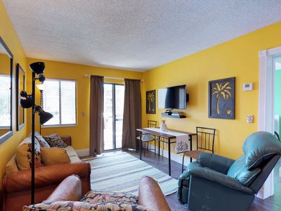 Photo for NEW LISTING! Colorful condo w/shared pool, hot tub & fitness center- near beach