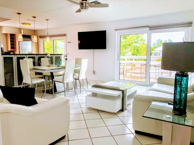 Photo for BLUE DOLPHIN ESTATE #2 - BOAT DOCK - NEW, 2BED MODERN WATERFRONT UNIT! WALK TO BEACH, POOL