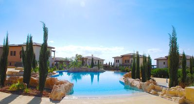 Photo for Modern 2 bedroom apartment 'AS11' with beautiful sea views, communal pool and resort facilities, Alexander Heights village on Aphrodite Hills
