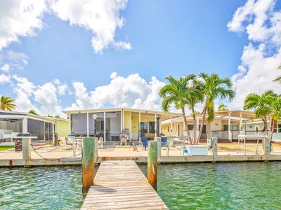 Photo for Canal front, dog-friendly getaway w/ water view & access to the Cabana Club!