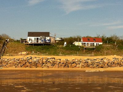 Photo for Waterfront Cottages with Spectacular Sunset  with wall of windows and AC