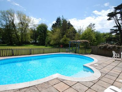 Outdoor solar-heated shared swimming pool