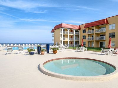 Photo for Updated waterfront condo w/ shared pool just steps from the no drive beach!
