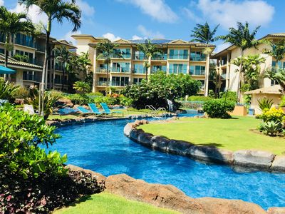 Beautiful 2 acre black lava rock pool with 2 slides and gardens