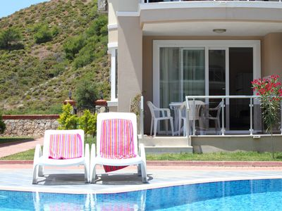 Photo for Beautiful beachfront apartment with pool in stunning location, sleeps 4