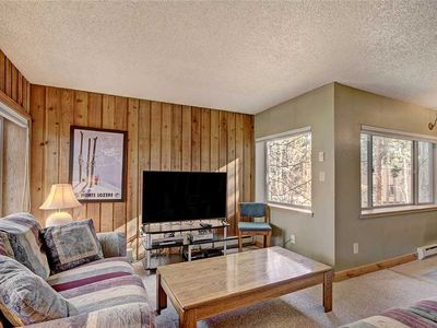Photo for Quick walk to downtown Breckenridge & ski lifts! Pool, hot tub & river-front complex!