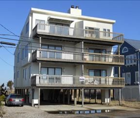 VIEWS! VIEWS! VIEWS! Enjoy fantastic Ocean and Bay Views from 4 decks.  Directly across the street to fantastic North End Beaches. Car port parking, Outdoor Shower, and Central air this unit has it all!