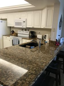 Recently remodeled kitchen with granite countertops.  Breakfast bar seats three.