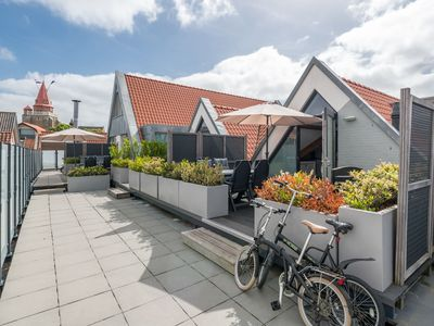 Photo for Magnificent 6-person apartment with roof terrace in Ouddorp town centre